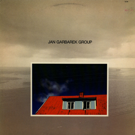 Jan Garbarek Group - Photo With Blue Sky, White Cloud, Wires, Windows And A Red Roof
